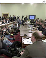 Hearing room with press photographers