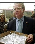 An attorney with a box of shredded documents