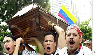 Protesters carry mock coffin for Chavez on Wednesday