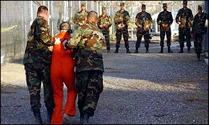US troops escort a prisoner to a cell at the Guantanamo Bay detention centre