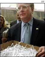 William Lerach, a lawyer representing Enron shareholders, carries shredded documents into a Houston court