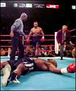 Orlin Norris floored by Tyson after the bell