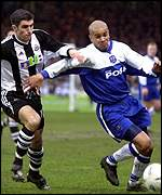 Peterborough's Leon McKenzie and Aaron Hughes