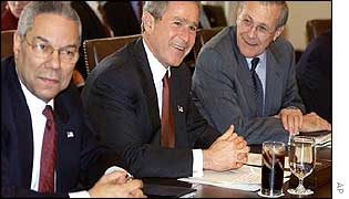 Colin Powell (left), President Bush (centre), and Donald Rumsfeld