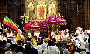 Ethiopian priest Arch Mandrite Abba Markos (centre) carries the tabot
