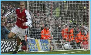Dennis Bergkamp scores for Arsenal against Liverpool