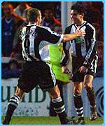 Alan Shearer congratulates his Newcastle team mate Jamie McClen who scored a goal