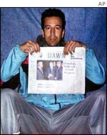 Daniel Pearl holds up Dawn newspaper in photo released by his kidnappers