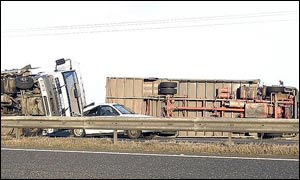 Two lorries lay on their side on the A1 south of Morpeth, Northumberland