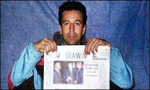 Daniel Pearl with copy of Dawn