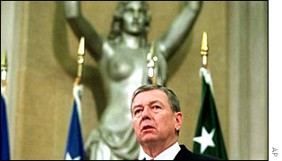 Attorney General John Ashcroft in front of the 'Spirit of Justice'