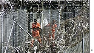 Detainees glimpsed behind the wire at Guantanamo Bay prison camp