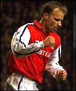 Dennis Bergkamp celebrates his first goal