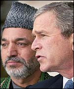 Afghan leader Hamid Karzai (left) and President George Bush