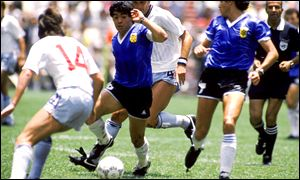 Diego Maradona bemuses England's defence in the 1986 quarter-final in Mexico
