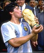 Diego Maradona kisses the World Cup he helped Argentina win in 1986