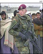 International Assistance Security Force soldier with Afghans