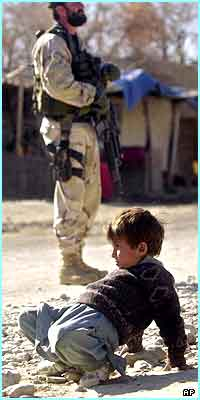 Soldiers on the street are a regular sight for Afghan children