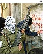 Armed Palestinians in the al-Amari refugee camp, near Ramallah