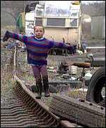 A traveller child playng on a disused railway line