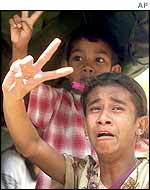 East Timorese refugees return home after being forced into Indonesian-ruled West Timor, 1999