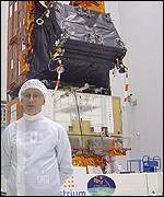 Derek Todman of Astrium in front of Envisat (BBC)