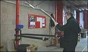 Worker with exhaust in Chester workshop
