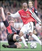 Southampton's Kevin Davies tackles Ashley Cole