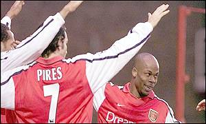 Wiltord, Pires and Henry celebrate Wiltord's record-breaking opening goal