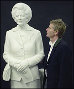 Sculptor Neil Simmons with the marble Thatcher