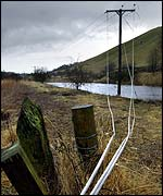 Power cables rest on the ground near Peebles