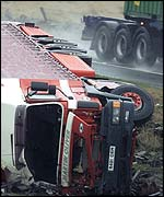 A lorry blown over by severe winds on the A69 near Carlisle, Cumbria
