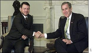 King Abdullah of Jordan shakes hands with President George W Bush