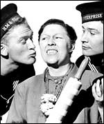 Gordon Jackson kisses Peggy Mount
