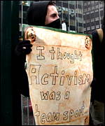 Protester holds sign 'I thought activism was a team sport'
