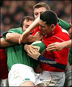 Stephen Jones is tackled by the Irish defence