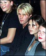 [ image: Posh Spice and David Beckham checking out trends]