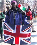 Joseph, a teenager who fled war in Sudan and has now lived in Salt Lake City since June last year, held up the Union Jack in the ceremony.