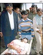Wounded man under police escort