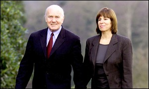 Dr Reid walks with fiancee Carine Adler at Hillsborough