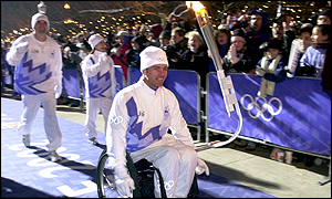 Paralympian Chris Waddell has the honour of bringing the flame into Salt Lake City