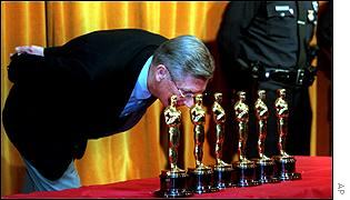 Academy boss Robert Rehme inspects his Oscars