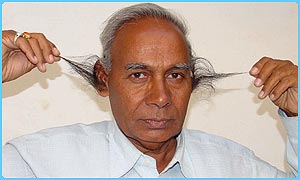 B D Tyagi of Bhopal in India with his long ear hair