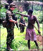British soldier talks to villager in Sierra Leone