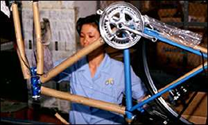 Chinese woman assembling bicycle