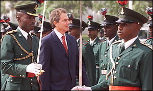 Tony Blair inspects an honor guard in Abuja, Nigeria