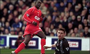 Heskey turns away after scoring Liverpool's second