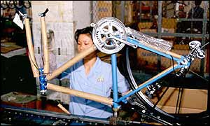 Woman in bicycle factory