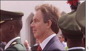 Tony Blair inspects a guard of honour at Abuja, Nigeria