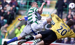 Henrik Larsson scores the second of his three goals